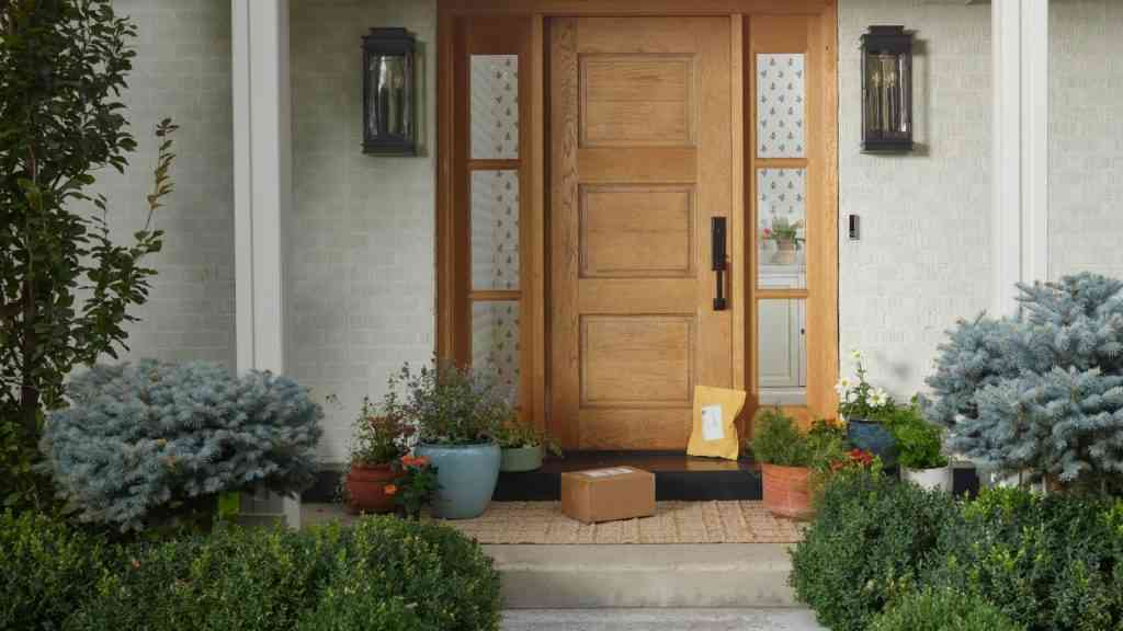 View of packages on front porch by door